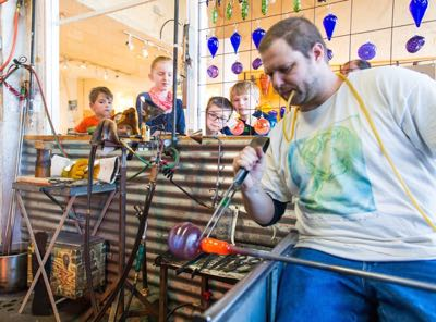 Kids watch glass blowing at Avalon Glassworks